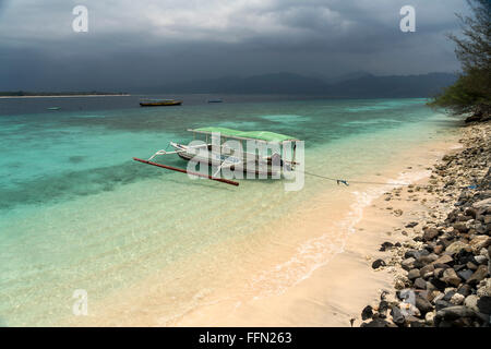 outrigger canoe at the beach on the small island Gili Meno, Lombok, Indonesia, Asia - Stock Photo