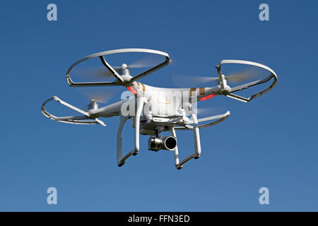A DJI Phantom 3 Professional quadcopter (or drone) with safety prop guards attached. - Stock Photo