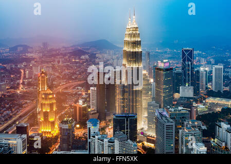 Aerial view of Kuala Lumpur city with the Petronas Towers, Malaysia, Southeast Asia at night - Stock Photo