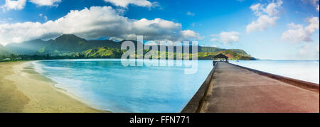 Hanalei Bay landscape and pier at dawn with the Na Pali coast in the background near Hanalei, Kauai, Hawaii - Stock Photo