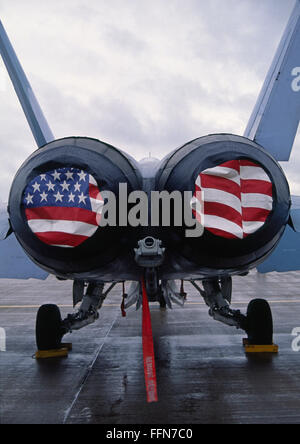 Patriotic American Flag covers on the rear of a USA F/A-18 Hornet fighter combat jet aircraft. - Stock Photo