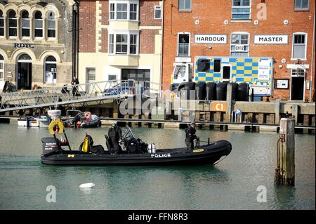 Police marine unit search Weymouth harbour for missing person, Dorset, Britain, UK - Stock Photo