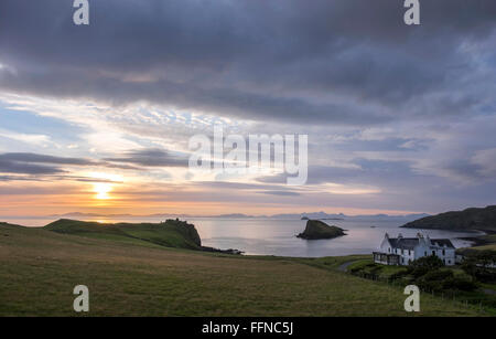 duntulm bay & castle with islet & hotel at sunset with harris on horizon
