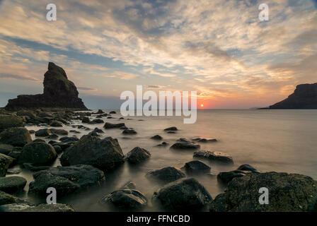 talisker bay at sunset rocks on shore at west coast
