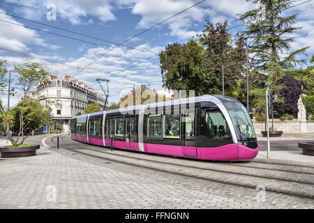 Modern tram on the street of city Dijon, France - Stock Photo