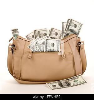 Purse Full of Money - Stock Photo