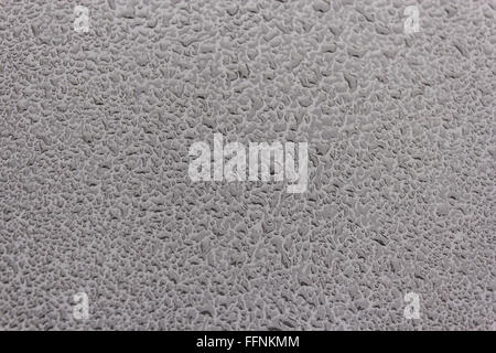 paint car rain raindrops waterdrops backlight black automobile underground metallic blue background water little - Stock Photo