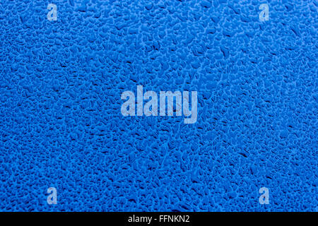 Waterdrops on blue car paint as background - Stock Photo