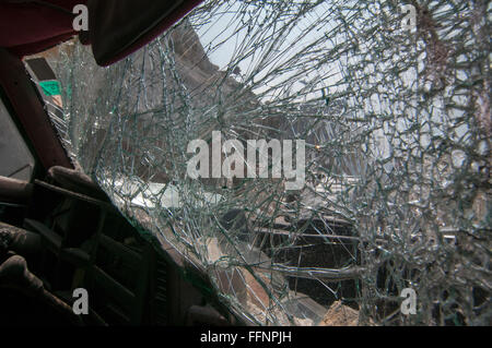 A crushed car sits in the street in Port au Prince after a 7.0 magnitude earthquake struck Haiti on 12 January 2010 - Stock Photo