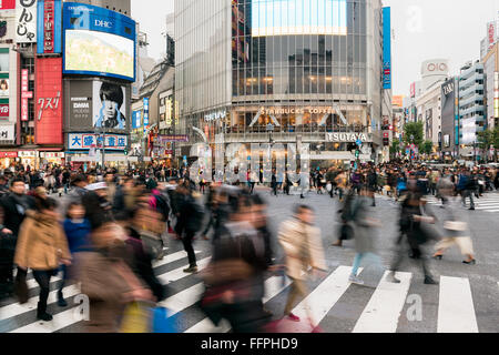 Tokyo, Japan - January 17, 2016: Evening rush hour at the famous Shibuya Crossing in Tokyo, Japan. - Stock Photo
