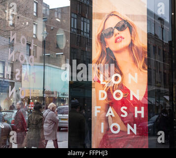 Billboard on a shop window celebrating London Fashion. It refers to the London Fashion Week that is held in London - Stock Photo