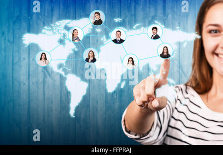 Portrait of a blurred young woman pointing finger at you against white background - Stock Photo