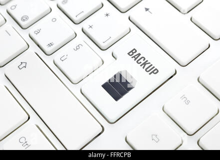 Backup safety storage technology concept. Hard disk button or key on white keyboard - Stock Photo
