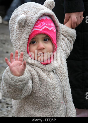 Portrait of a refugee girl (14 months) from Syria, now lives with her parents in the  tent camp 'Jungle' near Calais, - Stock Photo
