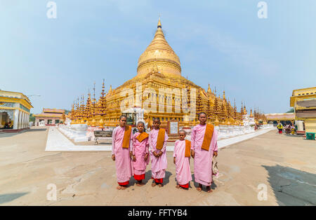 BAGAN, BURMA - 14 MARCH 2015: A group of monks before pagoda Shwezigon Pagoda in Bagan, Myanmar, Burma. - Stock Photo