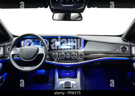 Car interior luxury dashboard & steering wheel. Wood decoration & blue ambient light. Cleaning and detailing car - Stock Photo