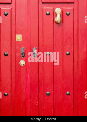 ... Red door close up with brass hand shaped knocker two locks two small ring handles and & Old door with iron studs and hinges Portugal Stock Photo Royalty ... pezcame.com
