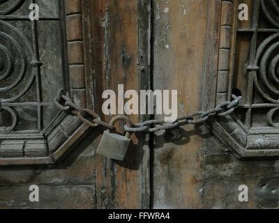 Rusty Chain Lock On Old Wooden Door - Stock Photo