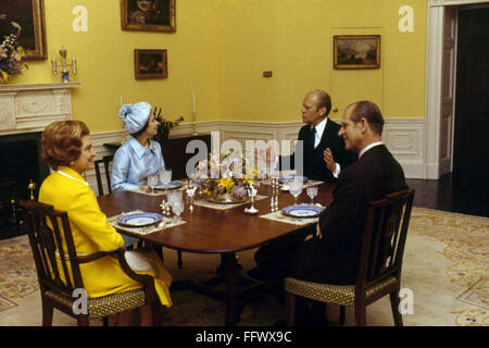 PRESIDENT AND QUEEN, 1976. /nPresident Gerald Ford and the First Lady entertaining Queen Elizabeth II of England and Prince Philip in the family dining room at the White House in Washington, D.C., July 1976.