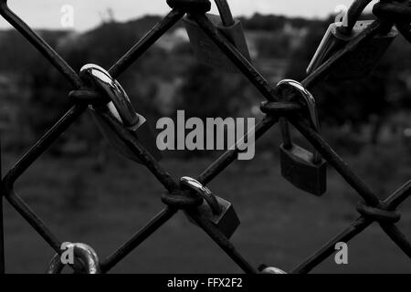 Close-Up Of Love Padlocks On Chainlink Fence - Stock Photo