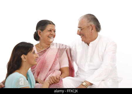 Young woman sitting down looking at old parents - Model Released # 703P, 703Q, 703S - Stock Photo