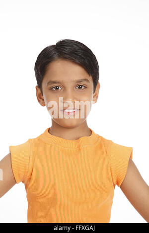 Ten year old boy in satisfied mood MR#703V - Stock Photo