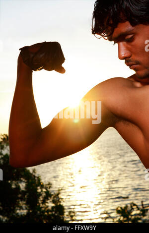 Boy looking at muscles MR#761B - Stock Photo