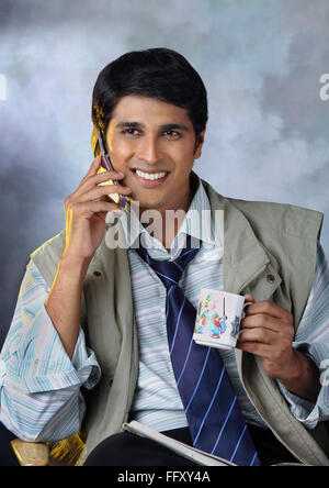 South Asian Indian man talking on mobile , India MR#732A
