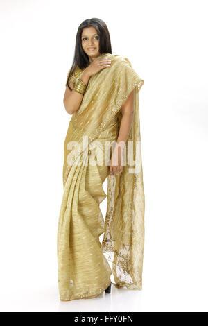 Indian lady standing in stylish pose wearing ceremonial silk sari MR#738