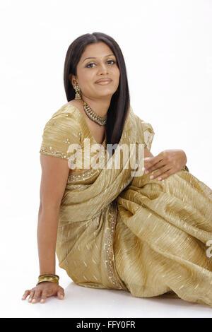 Indian lady sitting in stylish pose wearing ceremonial silk sari MR#738