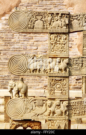 Details of south pillar of eastern gateway with three pales showing stories Buddha stupa No 1 Sanchi Bhopal Madhya - Stock Photo