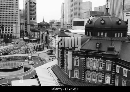 Tokyo Station Amidst Buildings In City - Stock Photo
