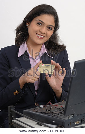 1 indian business woman laptop credit card shoping stock photo happy young business woman doing online shopping against white office going south asian indian lady showing credit card laptop on desk mr 670t reheart Images