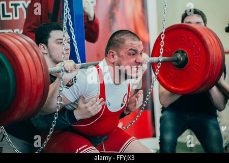 Chelyabinsk, Russia - February 12, 2016: male athlete of powerlifter squats barbell during West Asian championship - Stock Photo