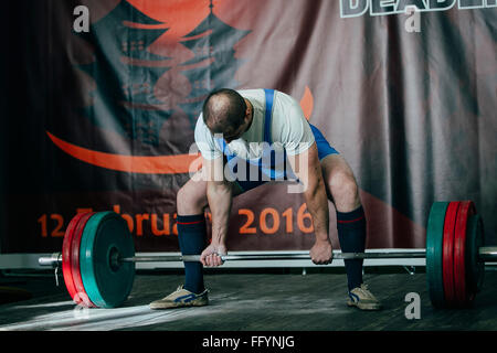Chelyabinsk, Russia - February 12, 2016: man powerlifter attempt deadlift heavy barbell during West Asian championship - Stock Photo