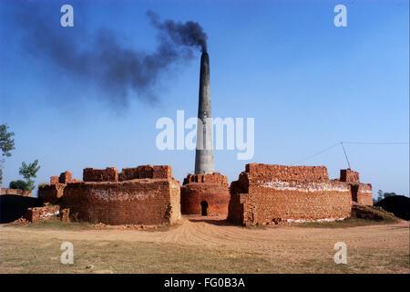 Smoke emitting out of chimney of brickyard , Village of Doulo Nangal in Amritsar, Punjab, India - Stock Photo
