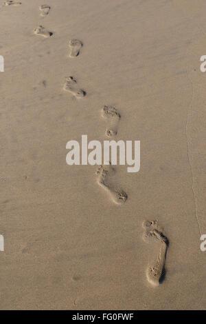 Footprints in sand at beach, Village Bhogwe , Konkan , District Sindhudurga , Maharashtra , India - Stock Photo
