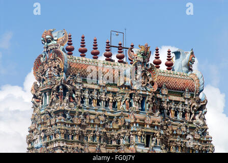 Richly decorated and Colourfully painted stucco figures on  gopuram Shree Meenakshi Sundareswara temple Madurai - Stock Photo