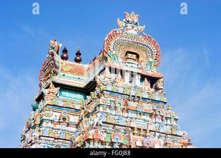 Gopuram richly decorated stucco figures impressive gateway Sri Ranganathswami temple Srirangam Tiruchirapalli Tamil - Stock Photo