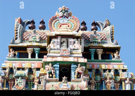 Gopuram richly decorated stucco figures on impressive gateway Sri Ranganathswami temple Tiruchirapalli Tamil Nadu - Stock Photo