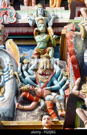 Deity Narasingha killing demon Hiranyashasipu gopuram Sri Ranganathswami temple Srirangam Tiruchirapalli Tamil Nadu - Stock Photo