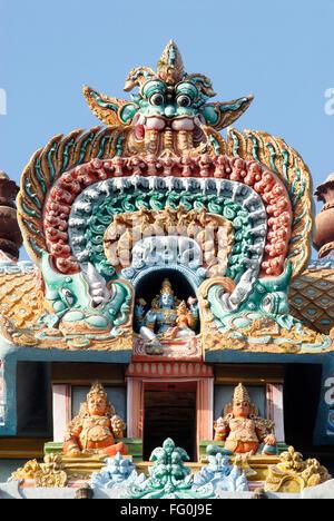 Gopuram with Colourfully painted richly decorated stucco figures deities Sri Ranganathswami temple Srirangam Trichy - Stock Photo
