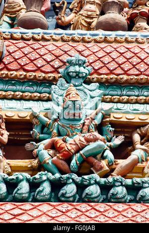 Narasingha killing demon Hiranyashasipu stucco figures Ranga gopuram Sri Ranganathswami Temple Srirangam Trichy - Stock Photo