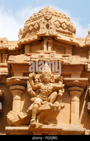 Statue of lord Kartikeya mounted on peacock on facade of Sri Arumugan temple inside Brihadeshwara temple Thanjavur - Stock Photo