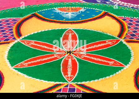 Rangoli festival coloured powder design in an indian for Floor rangoli design