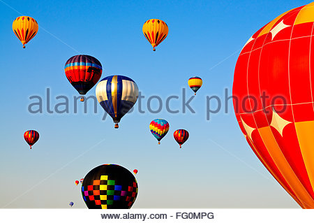 Colorful Hot Air Balloons Flying In Sky - Stock Photo