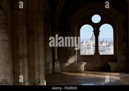 BUDAPEST, HUNGARY - FEBRUARY 02: Hungarian Parliament building seen from between Fisherman's Bastion's arches, at - Stock Photo