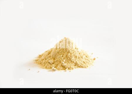 Indian herb Ashwagandha Churna powder ayurvedic medicine on white  background - Stock Photo