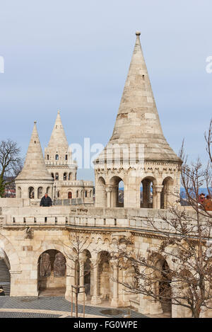BUDAPEST, HUNGARY - FEBRUARY 02: Tourists walking around Fisherman's Bastion spires, one of the attractions at the - Stock Photo