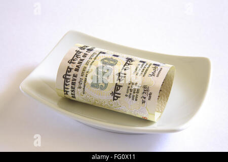 Concept , Indian currency five hundred rupees in plate - Stock Photo